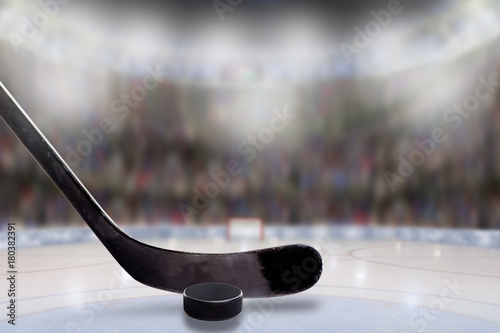Ice Hockey Stick and Puck in Rink With Copy Space