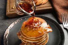Pouring Honey Onto Pancakes Wi...