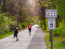 People Use City Bike And Walking Path In Urban Washington DC