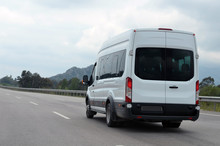 Minibus In Motion On A Background Of Mountains