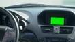 Inside a car. A GPS module is on. Green screen. Close-up shot