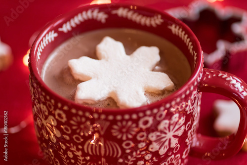 Spoed Foto op Canvas Chocolade Closeup of festive winter mug of hot chocolate with pretty snowflake shaped marshmallow
