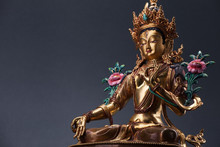 Bronze Figurine Of A Green Tara With Copyspace.