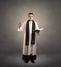 Young Priest In Giving His Ble...