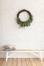 Wreath Hanging On White Brick ...