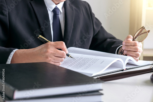Male lawyer or judge working with Law books, gavel, report the case on table in Canvas-taulu