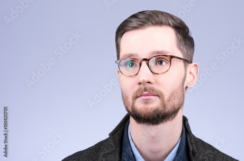 30a5fbf21ccd Horizontal closeup portrait of a stylish young suicine glasses. Mustache  and beard, neat hair