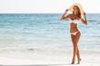 Woman in sunhat on beach