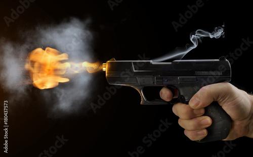 Stampa su Tela shot gun black fire smoke black background sparks flight bullets hand finger pre