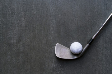 golf ball and golf club on black background