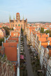 Old residential buildings, Mariacka Street and St. Mary's Church at the Main Town (Old Town) in Gdansk, Poland, viewed from above in the morning.