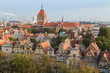 Old residential buildings at the Main Town (Old Town) and St. Cathrine's Church in Gdansk, Poland, viewed from above in the morning.