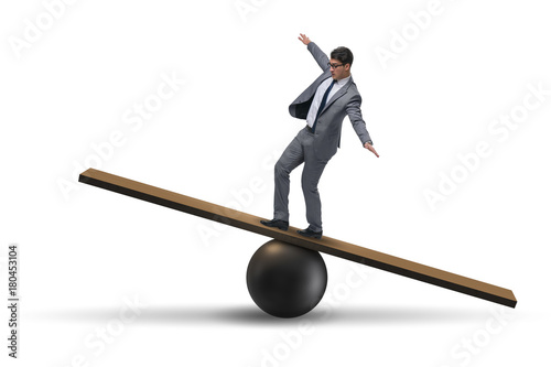 Fotografie, Obraz  Businessman balancing on seesaw in uncertainty concept