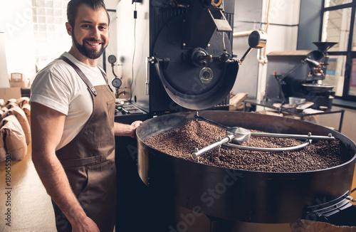 Fotografija Portrait of happy unshaven male having job at factory