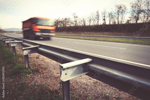 Spoed Foto op Canvas Stadion Truck driving on asphalt road