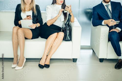 Aluminium Prints Akt Hispanic Businesswoman Outside Office On Mobile Phone