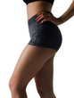 Beautiful sports female body on a white background. Slender waist and elastic buttocks. Sport and sports healthy food