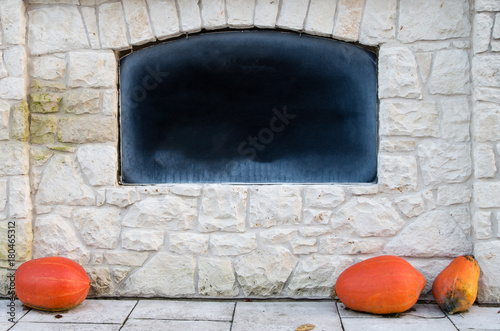 Poster Spirale Empty blackboard in stone wall with chalk rubbed out, Advertising Isolated copyspace, Orange Pumpkin on the ground