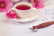 Good morning greeting note, calligraphy tool, pink flowers and coffee