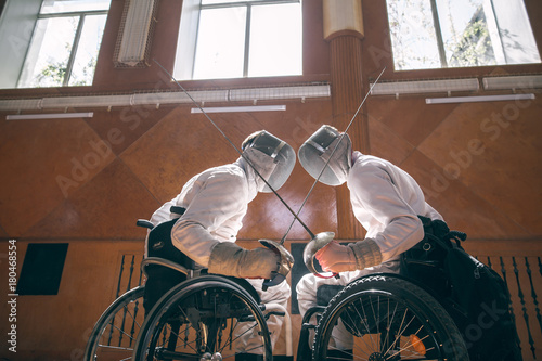 Valokuva  Two male disabled fencing athletes fight
