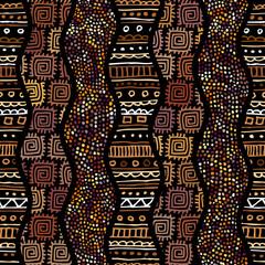 Naklejka Ethnic boho seamless pattern in african style on black background. Tribal art print. Irregular polka dots pattern.