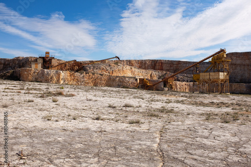 Former stone quarry with abandoned crusher and conveyor machines Wallpaper Mural