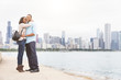 Happy black couple embracing in Chicago