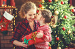 canvas print picture happy family mother and daughter giving christmas gift