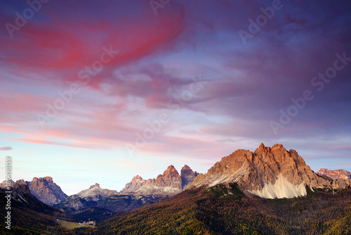 Fotobehang Aubergine Cadini di Misurina and Tre Cime di Lavaredo in sunset light, Dolomites, Italy, Europe