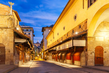 View Across The Famous Bridge Ponte Vecchio At Night In Florence, Tuscany, Italy