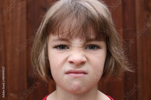 Fotografering  Portrait of an angry little girl