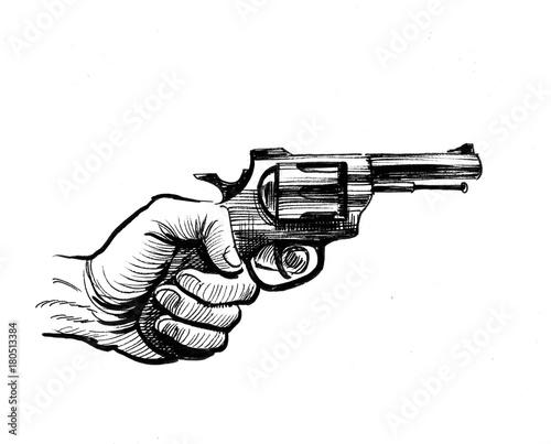 Fotografie, Obraz Hand holding a revolver