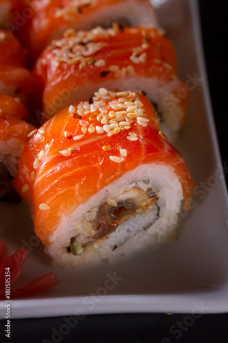 Japanese sushi rolls dish in white plate close up on darkbackground Canvas Print