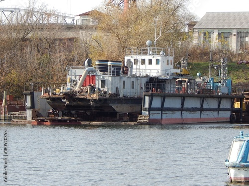Fotografia, Obraz  Dredging the vessel is in the floating dock for repairs. Photo.
