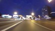 Night road POV through the city at night timelapse blue hour