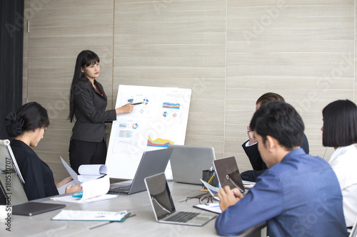 Fototapety, obrazy: Asian Business Woman presenting her work with team at the meeting room, People working Concept.