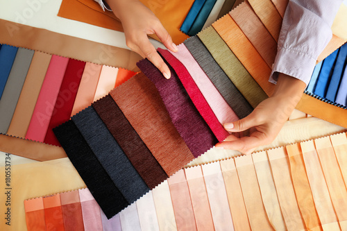 Aluminium Prints Fabric Young woman with fabric samples for curtains at table