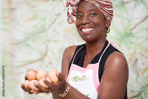 young woman holding organic eggs