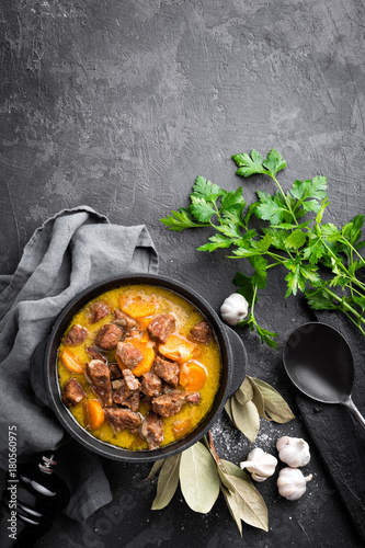 Meat stew, goulash in a cast iron pot, top view