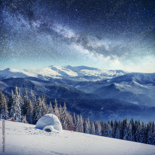 starry sky in winter snowy night. fantastic milky way in the New Year's Eve. In anticipation of the holiday. Dramatic scene. Carpathian. Ukraine