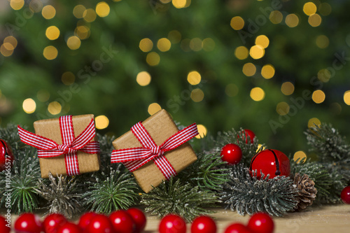christmas gifts and ornament on wooden floor lights bokeh background