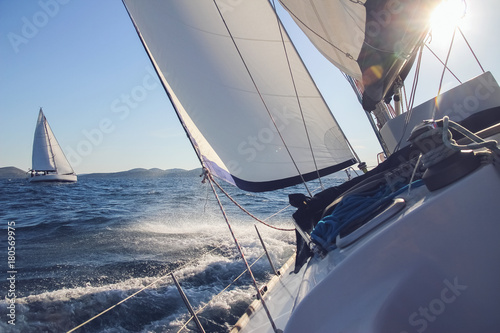 Sailing in the wind through the waves, yachts at sailing regatta