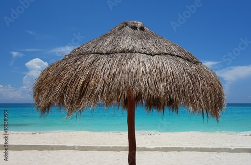 A Palapa Thatched Palm Tree Sun Umbrella On The Beach In Cancun Mexico