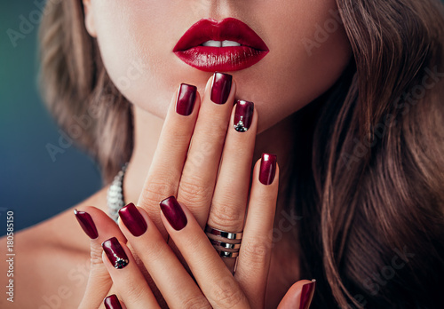 Deurstickers Manicure Beautiful woman with red lips and manicure