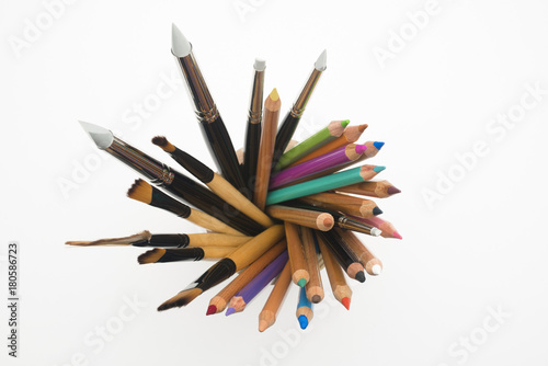 Crayon and brush in penholder from top Slika na platnu