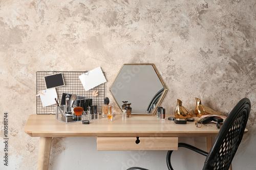 Cosmetic set on wooden dressing table Fototapeta