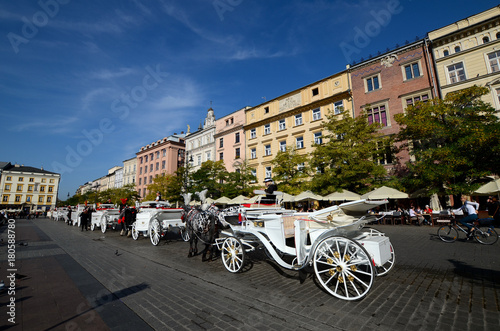 Cab on the main square - old town in Krakow, Poland Canvas Print