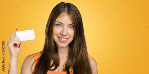 Obraz young woman holding sign board - fototapety do salonu