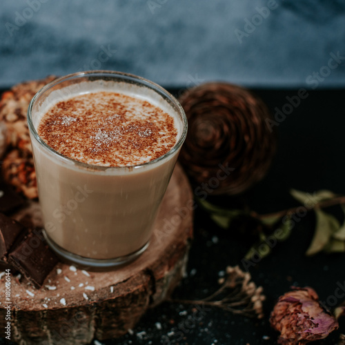 Foto op Canvas Chocolade Hot cappuccino on rustic background