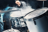 Drummer rehearsing on drums before rock concert. Man recording music on drum set in studio
